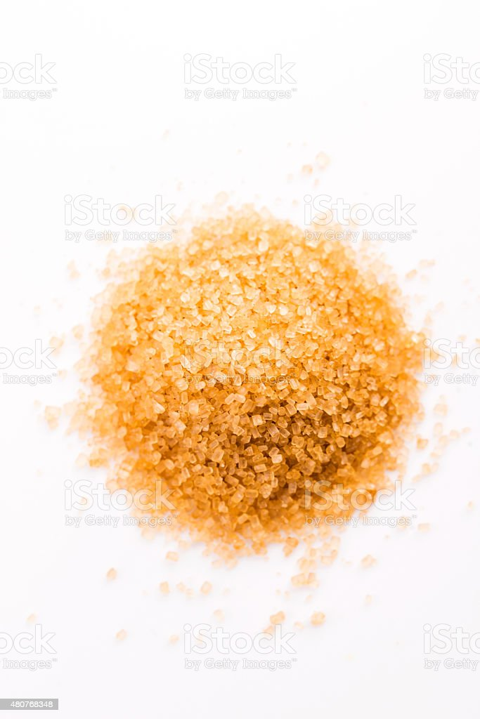 Crystals cane sugar heap close up isolated on white stock photo