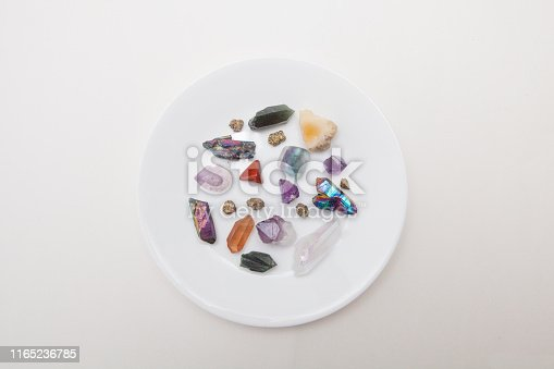 182911283 istock photo Crystals in a plate 1165236785