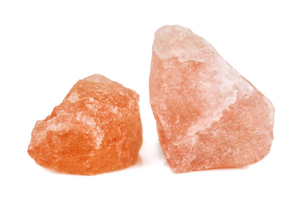 crystals of pink Himalayan salt on white stock photo