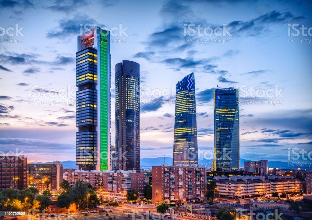 cuatro torres financial district skyline at dusk, Madrid. Spain cuatro torres financial district skyline at dusk, Madrid. Spain Architecture Stock Photo