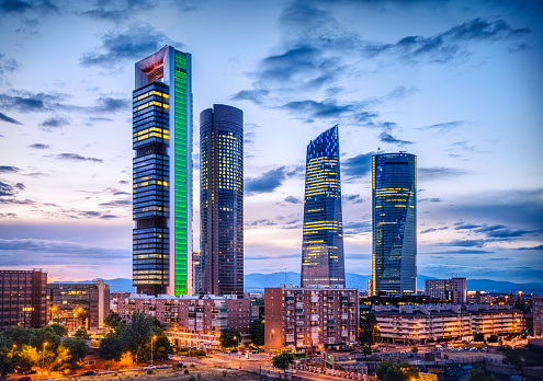 Cuatro Torres Financial District Skyline At Dusk Madrid Spain Stock Photo - Download Image Now