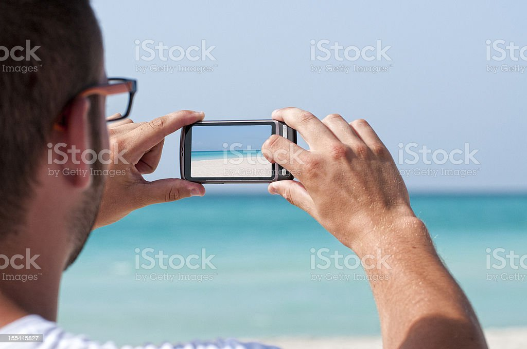 Cuba - Photographing with mobile phone royalty-free stock photo