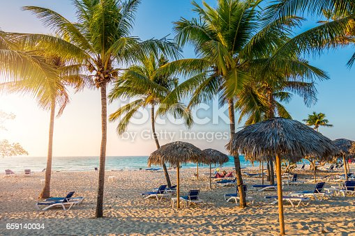 istock Cuban beach with sun lounger and palms 659140034