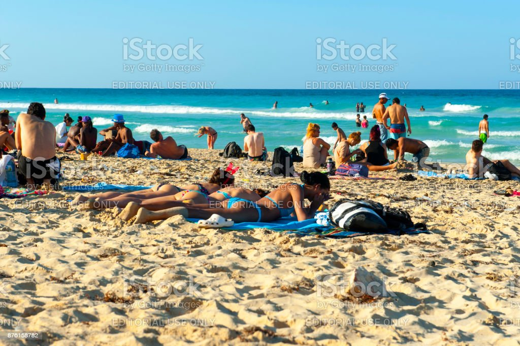 Cuban Beautiful Girls Sunbathing On The Beach In Havana Royalty Free Stock Photo