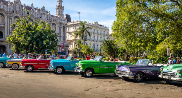cuban colorful vintage cars in front of the gran teatro - havana, cuba - cuba stock photos and pictures