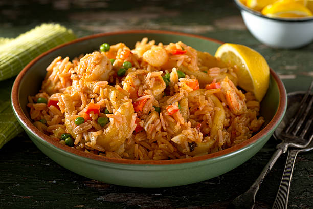 Cuban Cuisine - Arroz con Mariscos A bowl of delicious cuban Arroz con Mariscos - rice with seafood. arroz stock pictures, royalty-free photos & images
