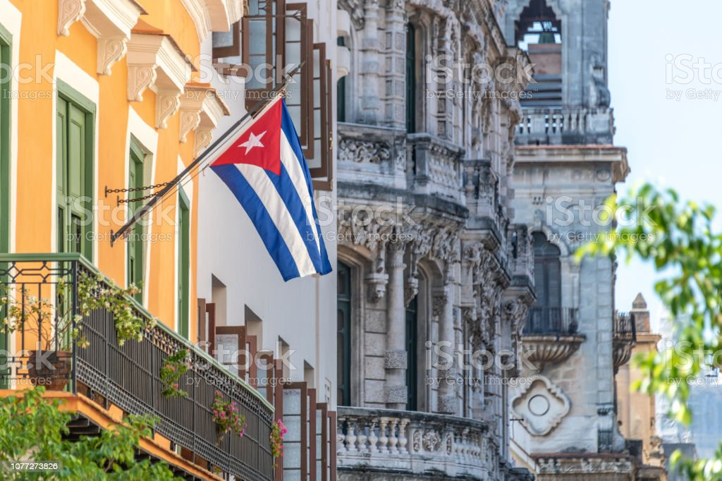 Cuban flag flying outside a building on a street in old Havana stock photo
