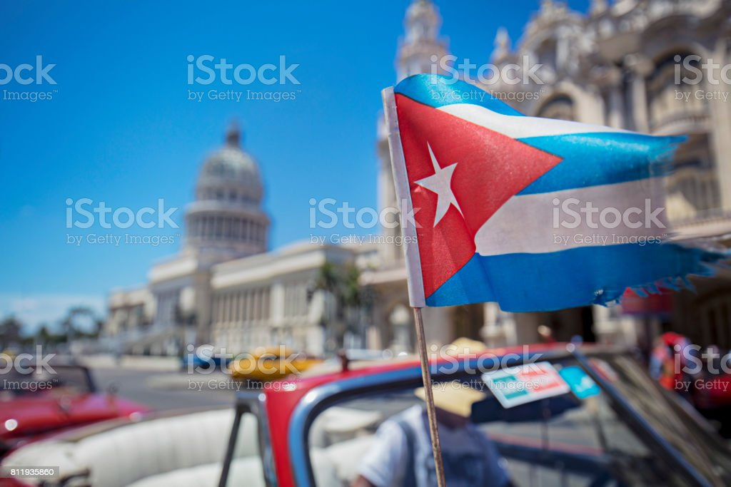 Cuban flag in motion against Capitolio stock photo