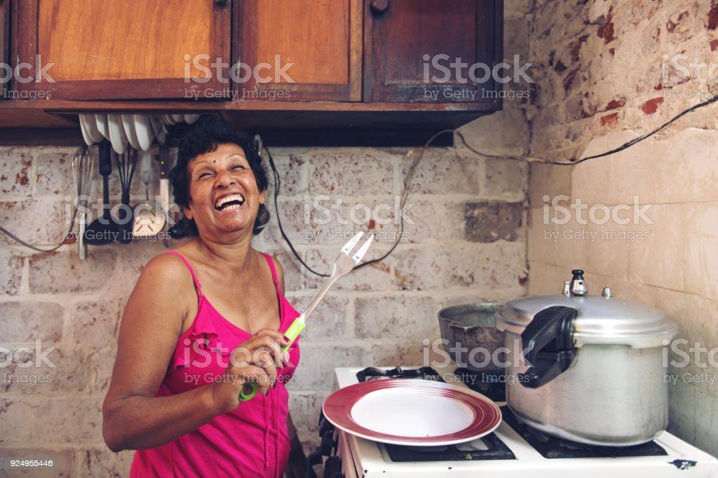Cuban grandmother cooking stock photo