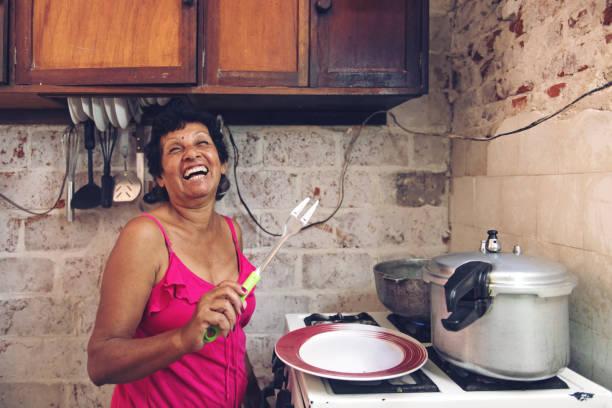 cuban grandmother cooking - caribbean food stock photos and pictures