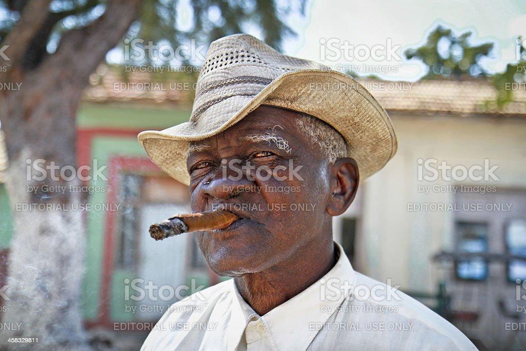 Cuban man smoking a cigar. Trinidad, Cuba. royalty-free stock photo