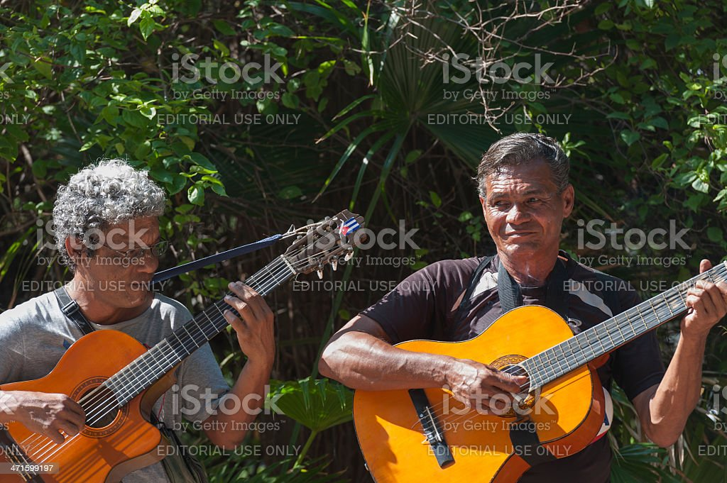 cuban man smoking a sigarte and playing the guitar royalty-free stock photo