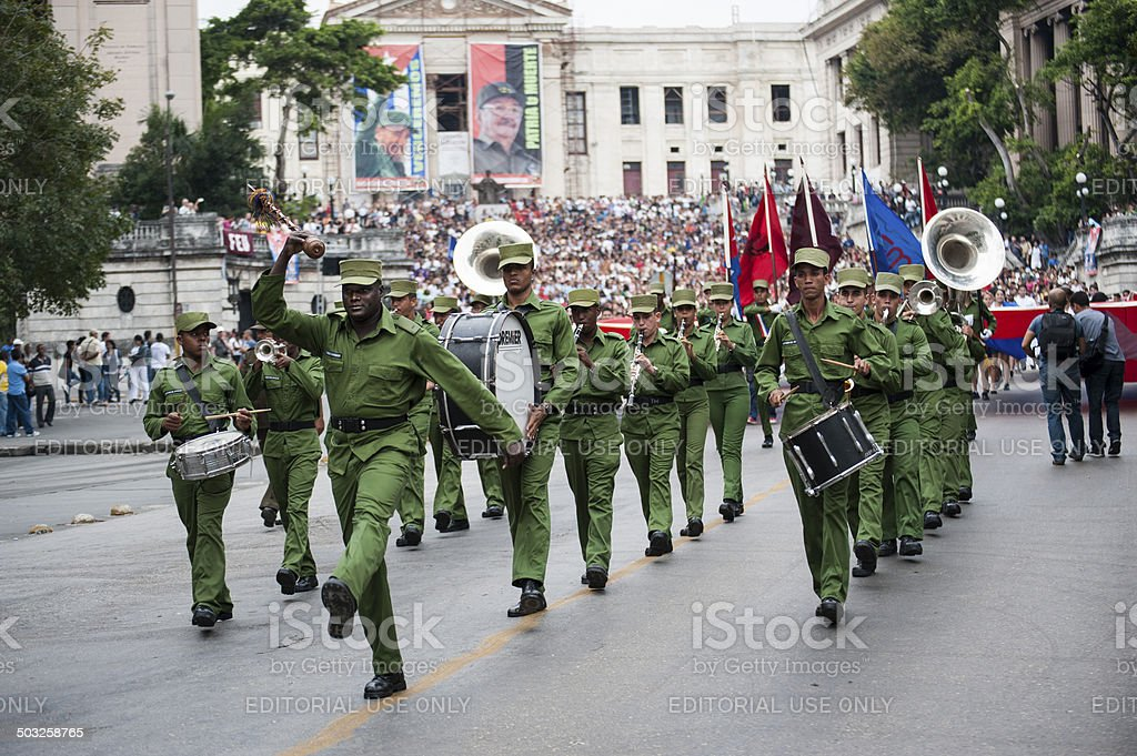 Cuban military band marches and plays at rally stock photo