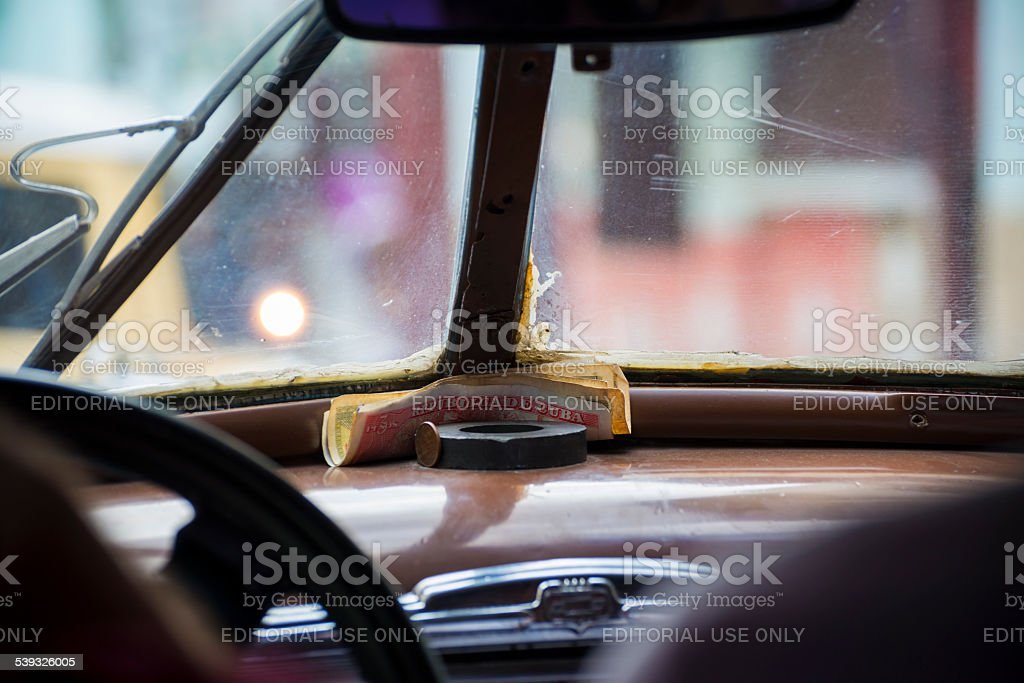 Cuban money in an old Chevrolet taxi stock photo