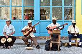 Male Cuban street musicians playing Cuban music the streets of Old Havana, Cuba