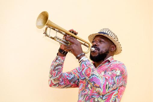 Cuban musician playing a trumpet outdoors, Havana, Cuba