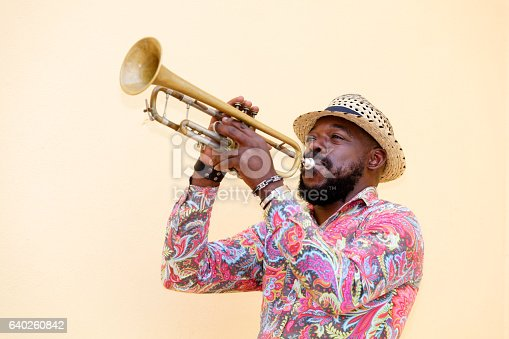 Cuban musician playing a trumpet outdoors, Havana, Cuba