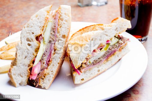 Cuban Sandwich with roasted pork, pickle, fries and soft drink
