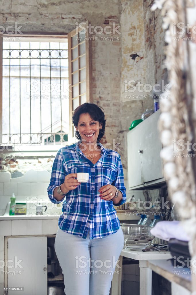 Cuban woman in kitchen stock photo