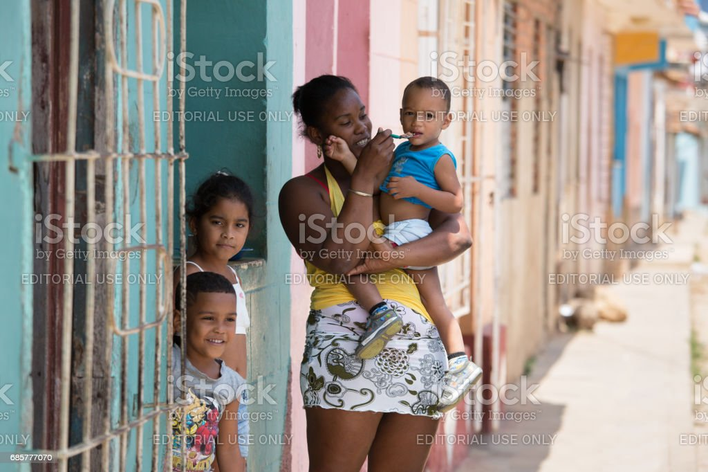 Cuban woman with her young children royalty-free stock photo