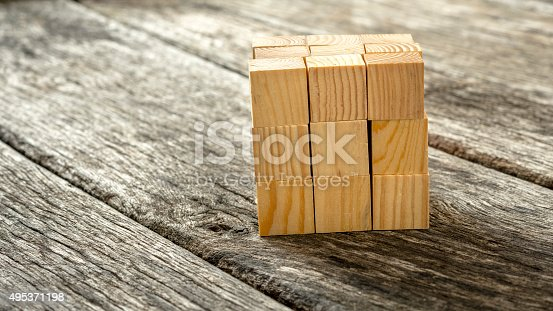 istock Cube assembled from 27 smaller wooden cubes 495371198