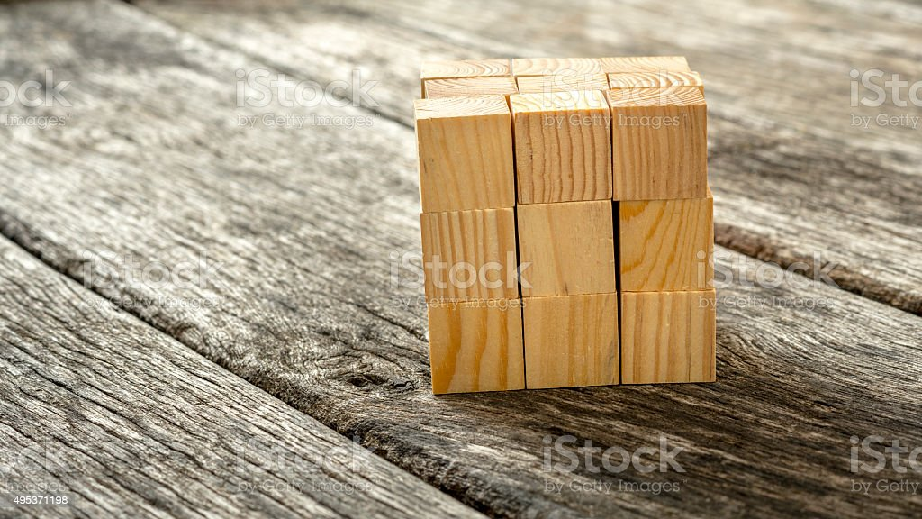 Cube assembled from 27 smaller wooden cubes stock photo