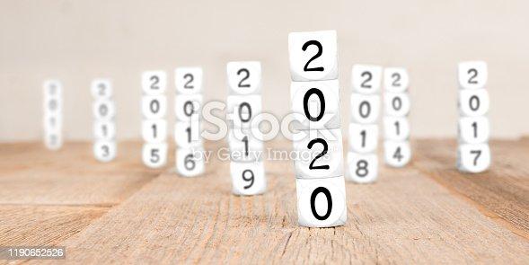 619522908istockphoto Cube Blocks with New Year 2020 1190652526