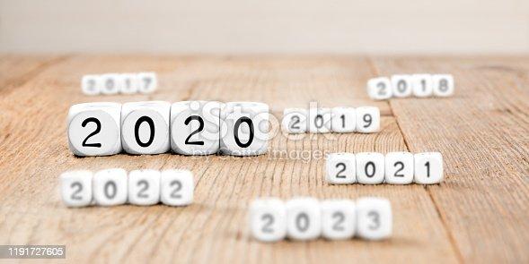 619522908istockphoto Cube Blocks with New Year 2020 1191727605