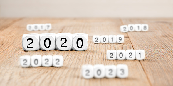 619522908 istock photo Cube Blocks with New Year 2020 1191727605