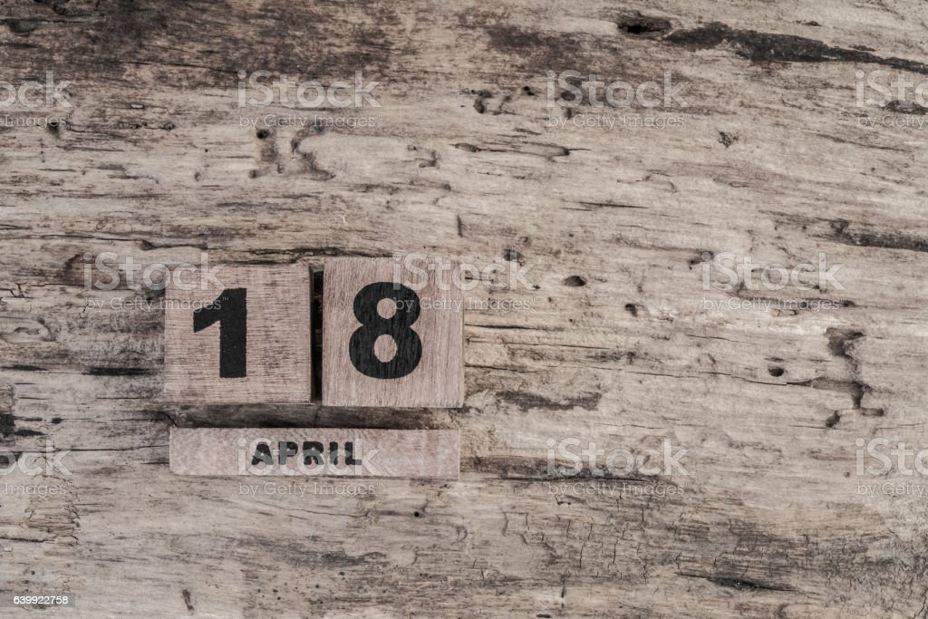 Cube calendar for april on wooden background stock photo