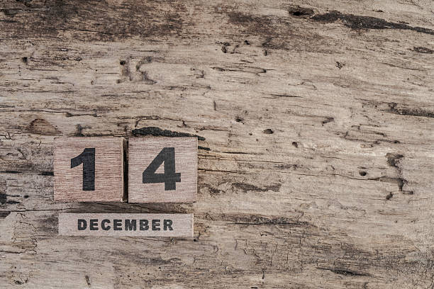 cube calendar for december on wooden background stock photo