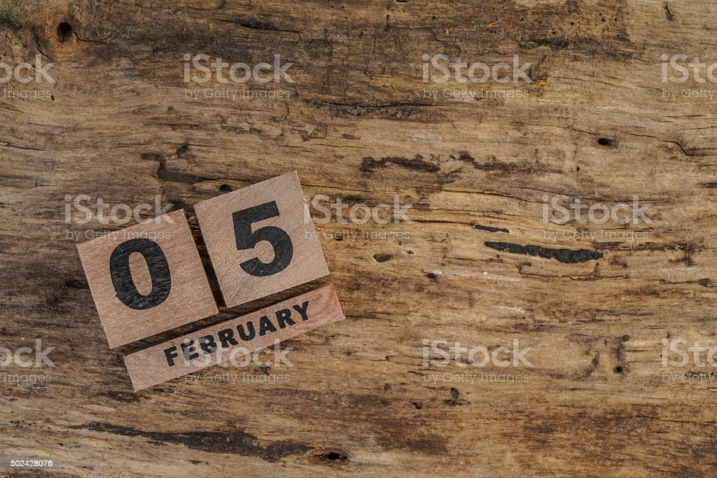 cube calendar for february on wood stock photo