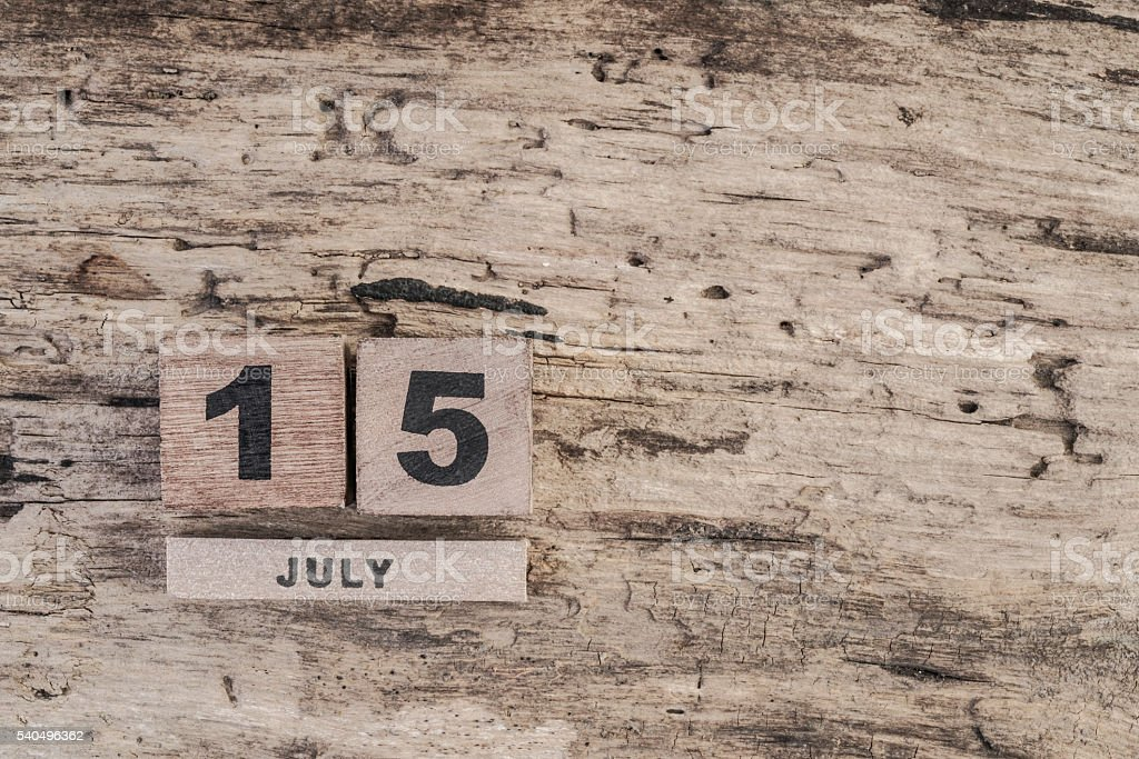 cube calendar for july on wooden background with copy space stok fotoğrafı