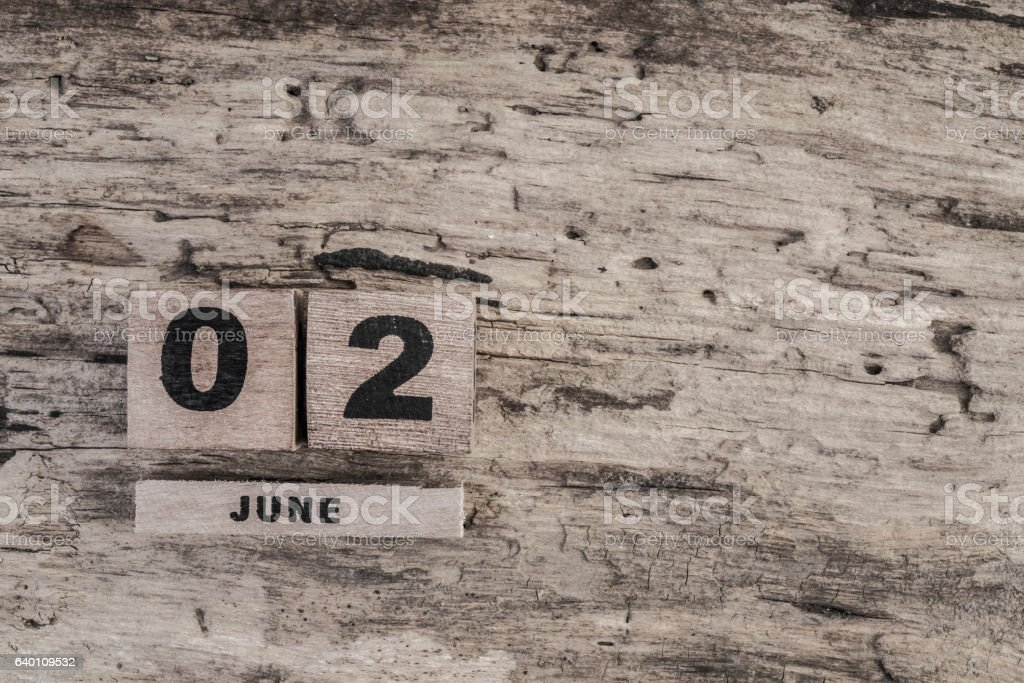 Cube calendar for june on wooden background stock photo