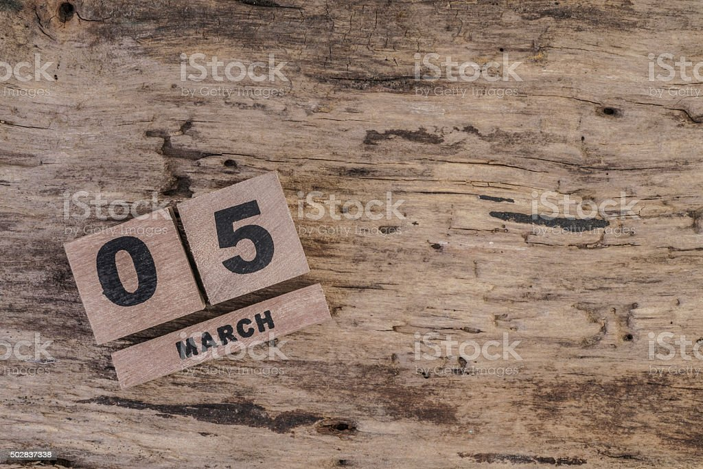 cube calendar for march on wooden surface stock photo