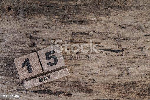 istock cube calendar for May on wooden surface with copy space 522745956