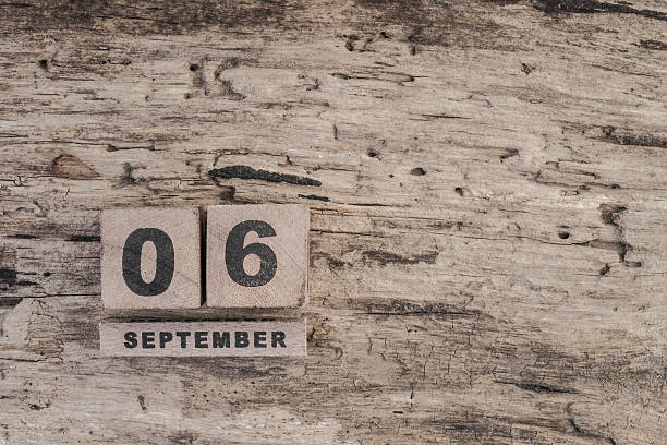 cube calendar for september on wooden background with copy space - number 6 stock photos and pictures