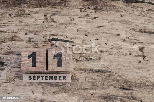 488008496istockphoto cube calendar for september on wooden background with copy space 541990830