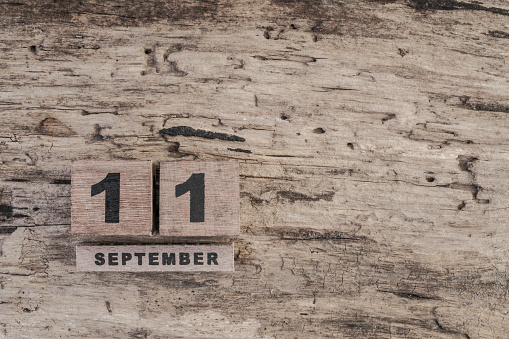 488008496 istock photo cube calendar for september on wooden background with copy space 541990830