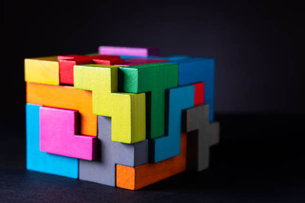 Cube made of multicolored wooden geometric shapes. stock photo
