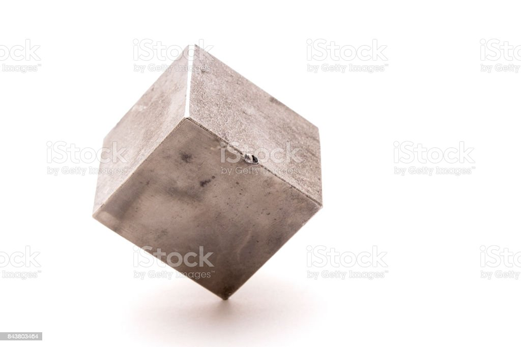 A cube of metal on white background stock photo