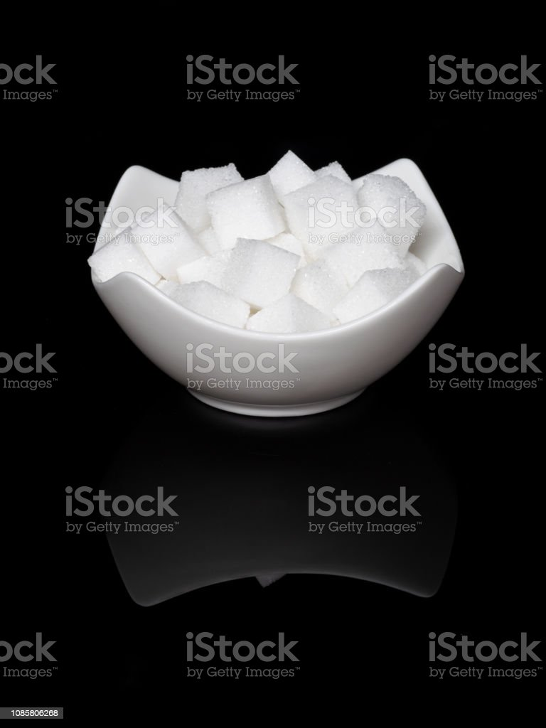 0566 Cube sugar, sugar cubes in an angular shell in front of black background, with mirroring stock photo