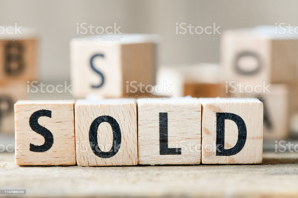 SOLD. Cube wooden block with alphabet building the word SOLD stock photo