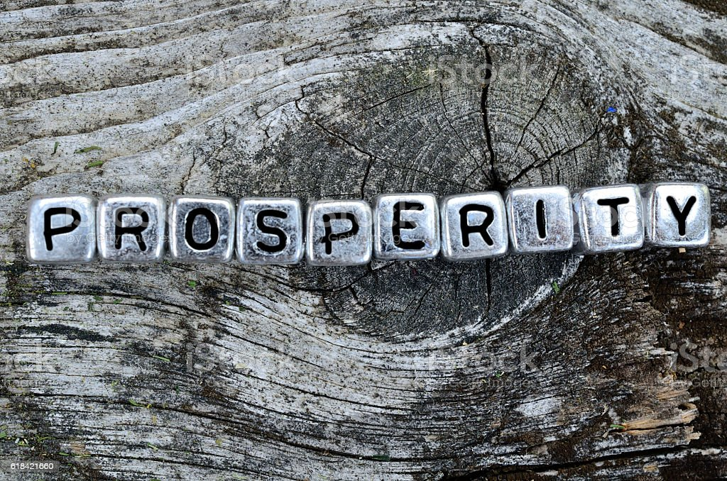 cube word prosperity on table stock photo