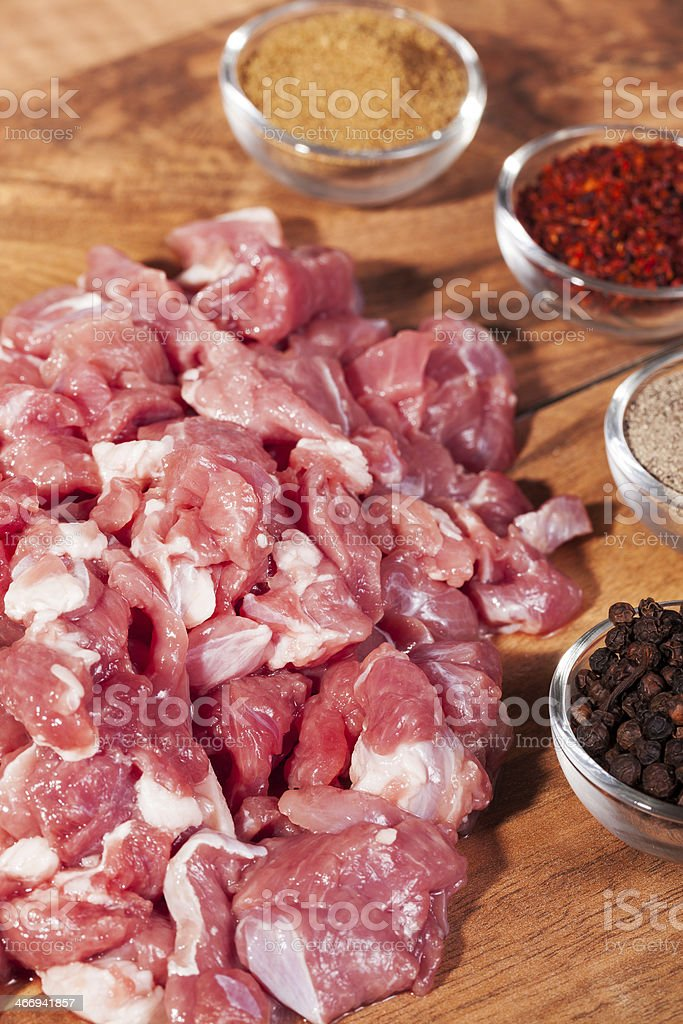 Cubed meat with spices royalty-free stock photo