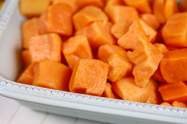 cubed sweet potato patate douce en cube sweet potato stock pictures, royalty-free photos & images