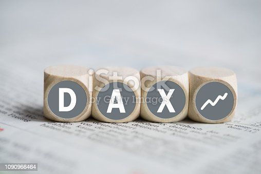 cubes forming the acronym DAX on a newspaper