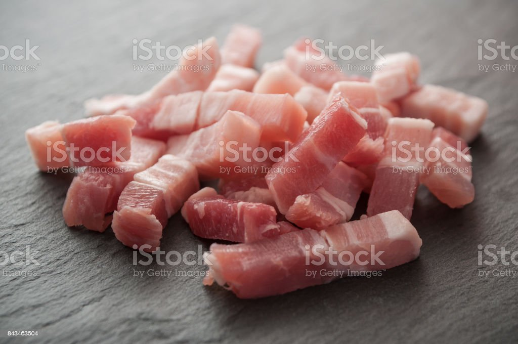 cubes of bacon on chalkboard background stock photo