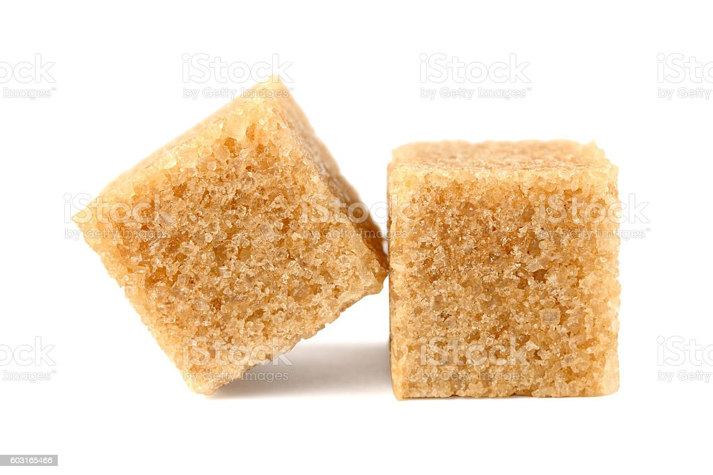 Cubes of brown sugar isolated on white background stock photo