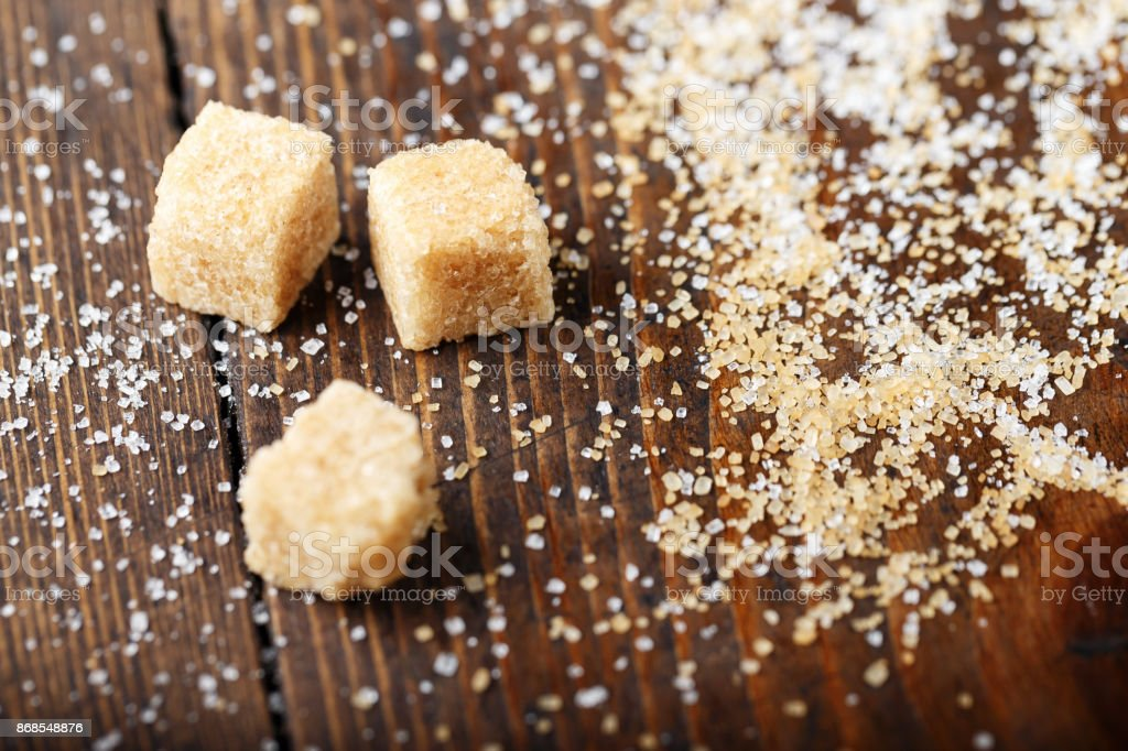cubes of brown sugar scattered stock photo